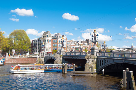 literally: Amsterdam-April 30: The Blauwbrug on April 30,2015, the Netherlands. The Blauwbrug (literally, blue bridge) is an historic bridge connecting the Rembrandtplein area with the Waterlooplein area. Editorial