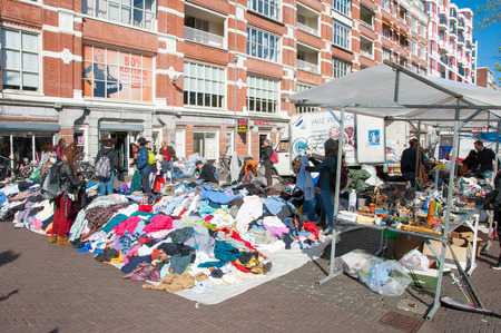 second hand: Amsterdam-April 30: Sale second hand clothing on daily Flea market on Waterlooplein (Waterloo Square), merchants display their bric-a-brac for sale on April 30,2015, the Netherlands.