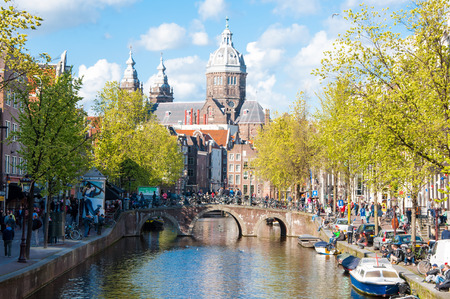 red light district: Amsterdam-April 30: Red light district, crowd of tourists go sightseeing, the Church of St. Nicholas is visible in the distance on April 30,2015, the Netherlands. Editorial