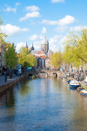 red light district: Amsterdam-April 30: Panorama of Red light district, the dome of the Church of St. Nicholas is visible in the distance on April 30,2015, the Netherlands.