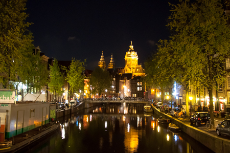 red light district: Amsterdam-April 30: Red light district at night, the Church of St. Nicholas is visible in the distance on April 30,2015, the Netherlands.