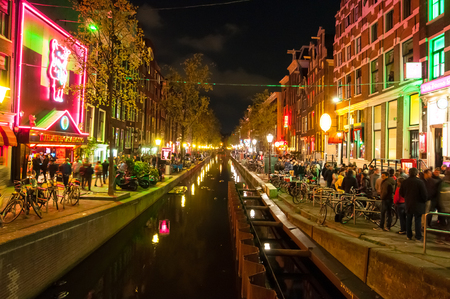 red light district: Amsterdam-May 1: Red light district Wallen at night with famous theatre Casa Rosso on the left hand side on May 1,2015 in Amsterdam, the Netherlands. Editorial