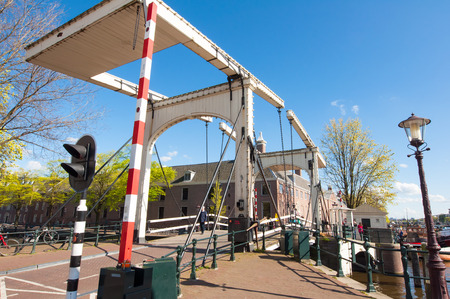amstel: Amsterdam-April 30: Magere Brug also known as Skinny Bridge on April 30, 2015, Netherlands. Bridge provides a nice spot to take in sweeping views of the Amstel river with the Carr Theatre close by.