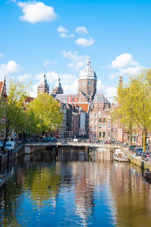 red light district: Amsterdam-April 30: Red light district, the Church of St. Nicholas is visible in the distance on April 30,2015, the Netherlands.