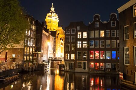 street drug: Red light district at night, the Church of St. Nicholas is visible in the distance, the Netherlands.