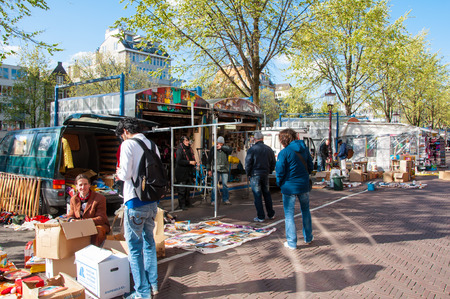 Amsterdam-April 30: Daily Flea market on Waterlooplein Waterloo Square, merchants display their bric-a-brac for sale on April 30,2015, the Netherlands.