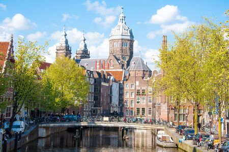 red light district: Amsterdam-April 30: Red light district, the Church of St. Nicholas is visible in the background on April 30,2015, the Netherlands.