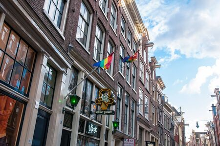 Amsterdam-April 30: Rainbow flags on the medival building in red light district on April 30,2015, the Netherlands.