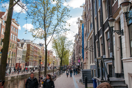red light district: Amsterdam-April 30: Amsterdams Red Light District, tourists go sightseeing on April 30,2015, the Netherlands. Editorial