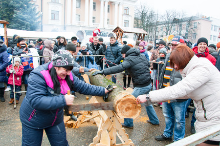 maslenitsa: RUSSIA, BRYANSK-MARCH 13: Undefined people take part in contest during Maslenitsa celebration on March 13,2016 in Bryansk city. Maslenitsa is a week-long festival before Great Fast. Editorial