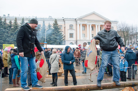 kokoshnik: RUSSIA, BRYANSK-MARCH 13: Undefined men with sacks take part in a fight contest during celebration of Maslenitsa on March 13,2016. Maslenitsa is a week-long festival before Great Fast.