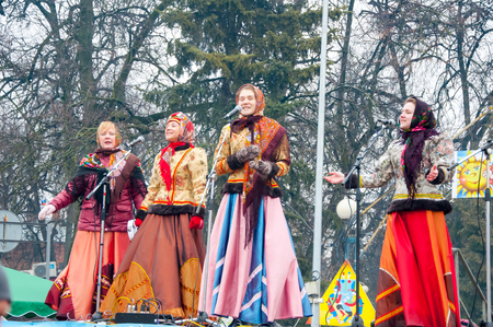 maslenitsa: RUSSIA, MOSCOW-MARCH 13: The group of women wearing traditional Russian clothers sing a song on Maslenitsa on March 13, 2016 in Moscow. Maslenitsa is a week-long festival before Great Fast. Editorial