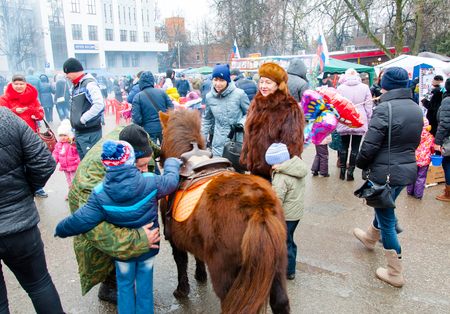 maslenitsa: RUSSIA, MOSCOW-MARCH 13: People celebrate traditional Russian holiday called Maslenitsa on March 13,2016 in Moscow. Maslenitsa is a week-long festival before Great Fast. Editorial