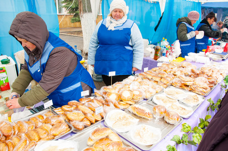 maslenitsa: RUSSIA, MOSCOW-MARCH 13:  Selling of traditional Russian meal on Maslenitsa on March 13, 2016 in Mascow, Russia. Maslenitsa is a week-long festival before Great Fast. Editorial