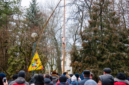 kokoshnik: RUSSIA, MOSCOW-MARCH 13: Traditional pole climb on wooden pole on Maslenitsa, people celebrate holidayon March 13, 2016 in Moscow. Maslenitsa is a week-long festival before Great Fast.