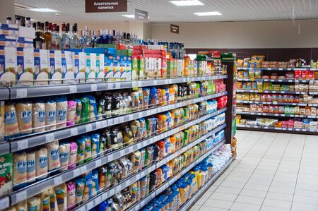 buisness woman: RUSSIA, MOSCOW-MARCH 13: Interior of typical Moscow supermarket on March 13,2016 in Moscow. Editorial