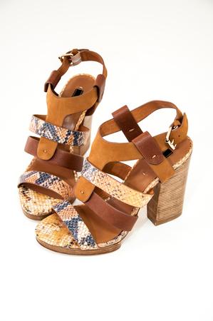 opentoe: Womens open-toe sandals decorated snake skin isolated on white background. Stock Photo