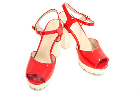 Pair of red womens high heeled patent shoes on white background. Stock Photo