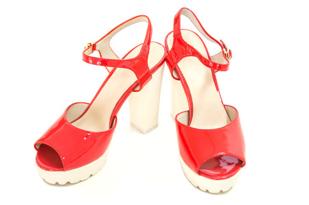 opentoe: Pair of red womens high heeled shoes on white background.