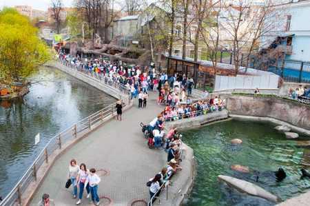 Moscow, Russia-May 01: Moscow Zoo full of people, crowd of tourists go sightseeing on May 01, 2017 in Moscow. There are two large territories in the zoo with a high bridge between them.