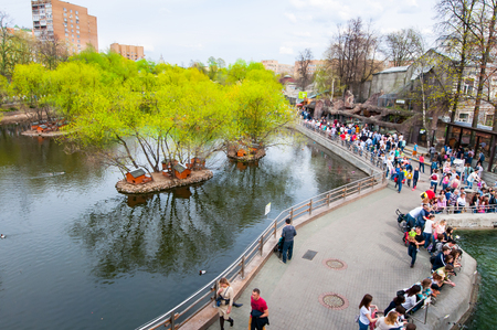Moscow, Russia-May 01: Moscow Zoo during the midday, crowd of people go sightseeing on May 01, 2017 in Moscow. There are two large territories in the zoo with a high bridge between them.