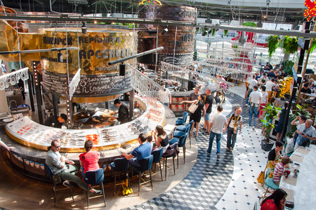 Moscow, Russia-May 27,2018: Modern Gastronomic Centre Zaryadye, people enjoy their meal. Redactioneel