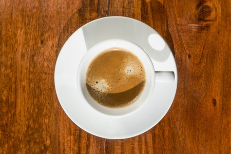 murk: Cup of coffee on a wooden table