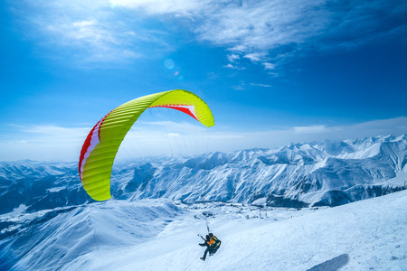 Winter in Greater Caucasus Mountains. Gudauri, Georgia (country). Paragliding