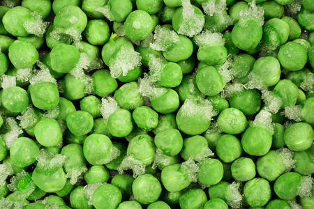 Close-up of frozen green peas with ice crystals. Food background.