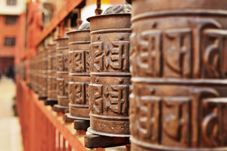 sanskrit: Line of copper praying drums Stock Photo