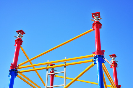 Colorful new scaffolding against bright blue sky Stock Photo