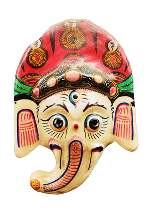 Ganesha (is one of the best-known and most worshipped deities in the Hindu pantheon) painted mashed paper (papier mache) mask on white background isolated with work path. Stock Photo