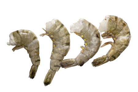 Fresh and wet raw tiger shrimps (tiger prawns) without heads and deveined ready for cooking, Isolated on white background with work path. Stock Photo