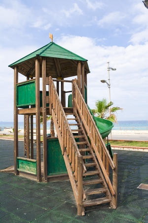 Green wooden structure games in a pubblic area next to the sea photo