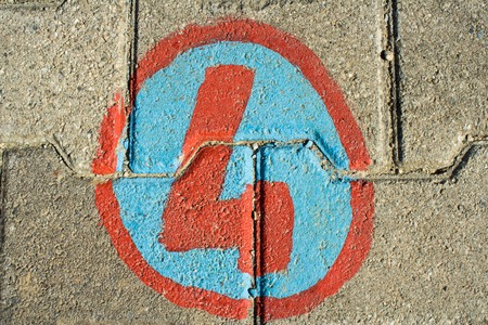 number four: Number four painted on bricks in the floor
