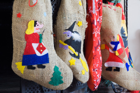 Epiphany witch socks in chimney during christmas holidays photo