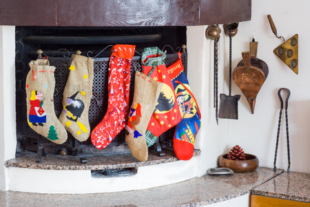 Chimney with epiphany socks during christmas holidays photo