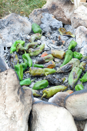 ember: Peppers roasted on ember and stones during a campground BBQ
