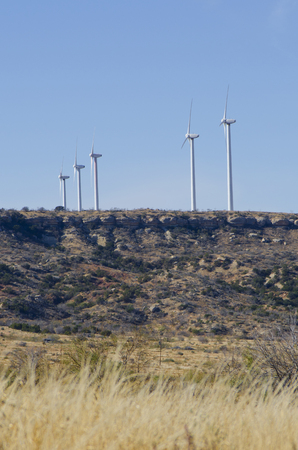 Five enormous wind turbines harness the winds of the Texas Panhandle for energy used throughout the state. Reklamní fotografie