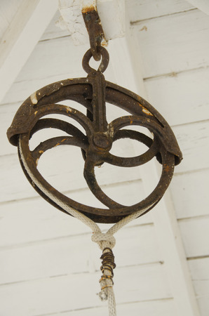 An authentic antique pulley hangs from the rafters.