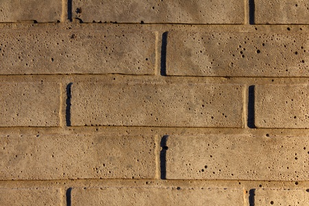 White concrete brickwall in afternoon sunlight