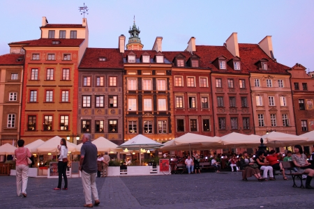 market place: Warsaw, Poland, June 28, 2011 - Warsaw Old Town Market Place with people and outdoor restaurants at sunset