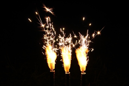 Cake fireworks candle firing on black background