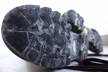 Old worn out soles of mountain trekking boots photo