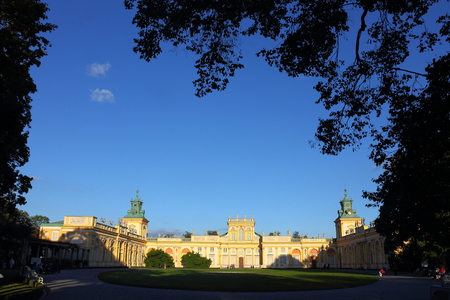 sobieski: Poland, Warsaw, Wilanow, 21 September 2013 - broad view of the front of king John III Sobieski s royal Wilanow Palace from 17th century framed by tree branches