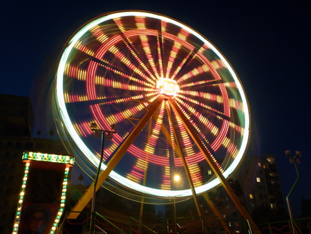Illuminated merry-go-round with blurred light circles photo