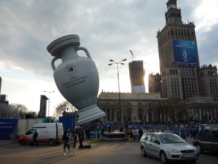 Poland, Warsaw, plac Defilad, 22 April 2012 - UEFA balloon in the shape of European Championship Cup with Palace of Culture and Zlota 44 residential tower under construction by Daniel Libeskind in the background