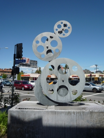 USA, California, Los Angeles, Hollywood, 29 April 2010 - film reel sculpture at gas station on Highland Ave