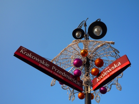 x mass: Poland, Warsaw, 31 December 2013 - decorated street lamp with Kr�lewska and Krakowskie Przedmie  347;cie street signs