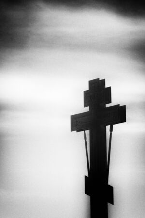 Black silhouette of an Orthodox cross and lantern in a black frame on a white background Stock Photo